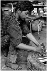 Strong arm! (~~~Saif~~~) Tags: new wheel nikon child labor year 1855mm nikkor bangladesh grasshoppers afs 1419 d5100 nikond5100