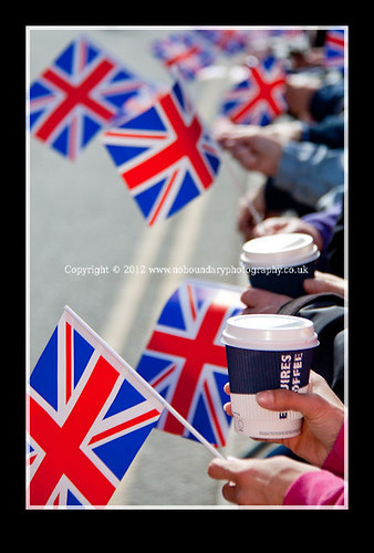 Local residents with Coffee and British Union Flags wait to meet Her Majesty The Queen-31