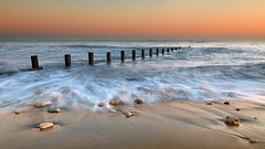 Flow (Tony N.) Tags: sunset france beach sand sable pebble plage ileder coucherdesoleil galet nikkor175528 d300s