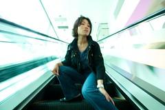 Escalator motion blur (K S Skaalrud) Tags: girl canon asian hongkong elevator motionblur slowshutter tst tsimshatsui 550d tamronspaf1024mm ksskaalrud