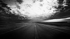 Vanishing Point - Dark (gfpeck) Tags: road clouds dark point long ominous northdakota straight vanishing