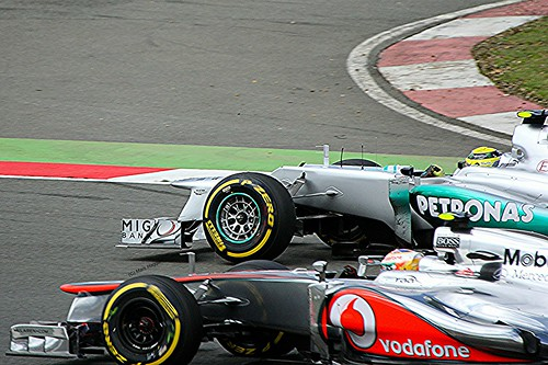 Mercedes Nico Rosberg nose to nose with McLaren's Jenson Button