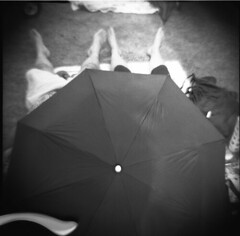 Relief Is Not a Black Brolly (BunnySafari) Tags: bw hot film feet guelph hillside dianaf heatwave fpp 2011 guelphlake ilford400 blackumbrella autaut bunnysafari hillsidefestivalguelph hillsidefestival2011