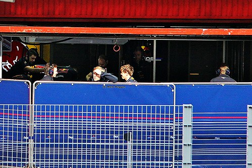 Sebastian Vettel and Christian Horner have a chat in the Red Bull Racing garage at Formula One Winter Testing in March 2012