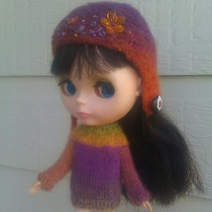 Mandy also got this new sweater by LauraKateIsCrafty, to go with a sweet Eurotrash helmet she already had! #blythecon2012
