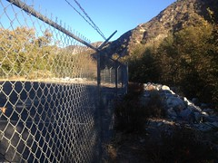 This is the fence line that you follow to get around into the wash to get into the canyon if you starting your hike over the bridge. On the other side Photo