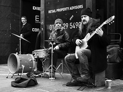 Rocking the bankers (CSHamilton) Tags: street blackandwhite bw monochrome 35mm glasgow candid expressions streetphotography buchananstreet buskers drummer busking guitarist guitarplayer streetmusician banker candidphotography glasgowstreetscene nikond90 glasgowstreetphotography
