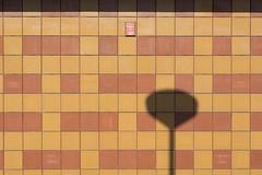 shadow of street lamp (Jan van der Wolf) Tags: map15144v shadow schaduw tiles tegels streetlamp lantaarnpaal pole minimalism wall muur