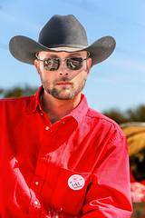 Cowboy (wyojones) Tags: houstonlivestockandrodeoparade texas houston houstonlivestockshowandrodeo parade trailride hat cowboyhat horse glasses sunglasses shades redshirt beard portrait outdoor wyojones