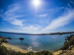 Fisheye View of the Jetty (Sareli0514) Tags: ocean ca beach clouds socal southerncalifornia orangecounty oc coronadelmar piratescove southcounty