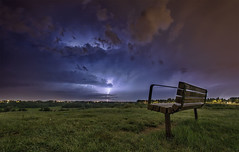 Calgary Lightning Storm (NicolasHesson) Tags: park blue sky calgary clouds bench landscape lightning yyc