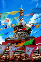 The wild Eastern Tibet of Kham-1255 large (frieda ryckaert) Tags: china stupa buddhism tibet tibetan kham prayerflags sichuan buddhisttemple    xiangcheng tibetanculture  buddhiststupa utsang tibetanstupa            xiangchengvillages chrten tibetanchrten