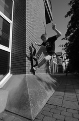 Wallride - Andrew Liddell (Tommy Woolley) Tags: camera friends boy white black blur brick field youth contrast digital speed canon dark lens nose person grey james photo back clothing high movement focus long exposure day place ride shot image action body board side skating north young scenic fast slide scene images spot front east deck f skate area shutter skateboard skater rough capture distance middlesbrough ghetto depth edit fs greyscale mccue focal 55200
