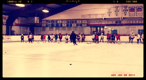 Brad Perry coaching a hockey school in Chicago