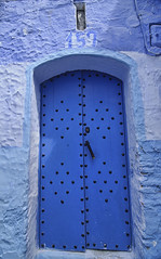 the colorful and atmospheric blue doors of Chefchaouen, Morocco (jitenshaman) Tags: africa door travel blue art architecture design paint mediterranean arch artistic morocco destination porte chaouen chefchaouen moroccan rif andalucian worldlocations