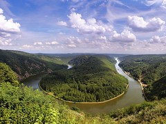 The river Saar has dug itself deep into the bedrock of Saarland (Bn) Tags: world blue summer sky panorama green castle heritage nature clouds forest river germany deutschland boat site topf50 ruins warm day cloudy loop hiking tourist rivire unesco explore bow vista meander through curve visitors montclair fluss viewpoint topf100 allemagne blick konz burg duitsland saar saarland bedrock aussichtspunkt saarschleife unspoiled rivier panoramicview sarre bocht mettlach cloef 100faves 50faves sinuosity ziegelberg saareck cloefpfad saarhunsrckstieg
