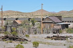 Steins - train passing in front of the old town (Charlotte Clarke Geier) Tags: southwest windmill saguaro outhouse stable wringerwasher livery caterpillarbulldozer steinsnm chloridenm winstonnm miningbucket gthosttowns drippingspringsnm lakevalleynm vanpattenscamp