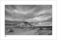 The Fortress (Clicker_J) Tags: lighting light bw mountain storm rock stone clouds america landscape utah blackwhite lowlight nikon shadows dunes rocky naturallight east mountainview hillside nationalparks eastern highlight stormclouds d300s