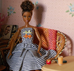 Malia in the Sunroom (Emily1957) Tags: malia barbie mattel fashion apple orangejuice wicker miniature toys toy light naturallight nikond40 nikon kitlens cottoncasual madetomovebarbieyogadoll shadows onebluestocking