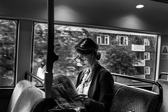 Libarian Girl (EyeOfTheLika) Tags: street old blackandwhite bw woman white black bus london monochrome rain lady asian photography glasses newspaper serious seat transport streetphotography lika elderly sit 500px ifttt