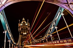 Tower lights (Paki Nuttah) Tags: city uk bridge england color colour building london tower architecture night dark twilight europe traffic hill flare gb flares flickrtravelaward