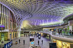 King's Swirl (Dan Chui (on/off!)) Tags: city uk travel england urban motion london colors architecture modern night train buildings geotagged lights evening nikon adobephotoshop unitedkingdom vibrant famous citylife railway landmark tourists ceiling illuminated indoors busy trainstation transportation handheld 24mm kingscross stpancras development metropolitan hdr girder concourse topaz railroadstation  noiseware  photomatix   niksoftware d700