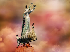The Sailor's Watchman (Susan Hall Frazier) Tags: color statue clouds contrast religious cross pastel icon bulgaria christianity sailor nautical blacksea seaport seasideresort patronsaint watchman nessebar nessebarbulgaria blackseaport blinkagain bestofblinkwinners blinksuperstars saintnicholasstatue southnessebarbay