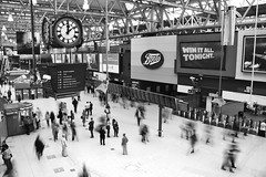 Waterloo Station ([~Bryan~]) Tags: city uk urban blackandwhite bw london clock station train underground time motionblur flickrmeet waterloostation