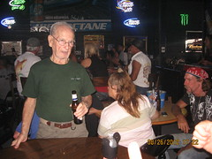 this guy had to be 80 and the chic in last couple of pictures was setting on his lap and he had his nose in her hooters having a big time.. He loved the ladies and didn't pass up a chance to grab one. (tuffcreek) Tags: hot cold wet rain wind florida hurricane bikes dry harley babes motorcycle leesburg silverfox crystalriver tuffcreek highoctanesaloon