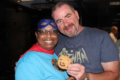 Batman (Jeff) offers a cookie to none-other-than the Cookie Monster (Julia)