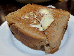 Buttered wheat toast (Coyoty) Tags: food brown white breakfast bread restaurant beige dof bokeh connecticut wheat toast ct diner diagonal crispy butter buttered depth toasted rockyhill townlinediner