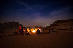 Enlighten the Desert (Themightyoak) Tags: light camp music blur mountains night stars fire sand desert 14 together sing rum 24mm wadi musa samyang