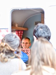 British photographer Martin Parr, in a little caravan, signs copies of his latest book on food. A cool idea. (alcowp) Tags: paris france promotion book photographer signing magnum martinparr