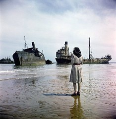A woman on Omaha Beach looks out at ruined ships used in the D-Day storming of Normandy, France. Photograph by David Seymour, 1947 [937x960] #HistoryPorn #history #retro http://ift.tt/1t8dH2t (Histolines) Tags: woman david france history beach by out ships retro used photograph timeline looks omaha seymour normandy dday 1947 ruined storming vinatage a historyporn histolines 937x960 httpifttt1t8dh2t