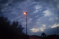 Three streetlamps and clouds (lucas2068) Tags: sky espaa valencia clouds sunrise spain streetlamp amanecer cielo nubes farolas
