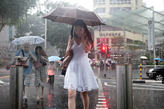 (danny st.) Tags: street people beauty rain photography nikon singapore candid streetphotography stranger 24mm nocrop upclose badweather orchardroad d300 dannysantos