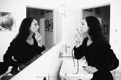 Put on some make-up (Afroditi Mavroeidi www.mavroeidi.com) Tags: bw woman white black berlin beauty face greek bathroom mirror long longhair makeup blackhair tegel ladiesrooom