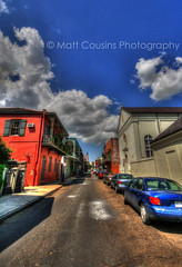 The French Quarter, New Orleans (Matt Cousins Photography) Tags: road street city blue windows summer sky orange usa cloud sun colour building travelling cars window car architecture clouds america canon fence buildings us bush orleans louisiana gate unitedstates path balcony flag neworleans unitedstatesofamerica perspective sigma sunny americanflag wideangle bluesky traveller sidewalk frenchquarter thesouth 1020mm hdr highdynamicrange usaflag sigma1020mm 10mm travelphotography buildingshadow sigmalens photomatix sigma1020 tonemapped tonemapping tonemap mergedimages frenchquarterneworleans highdynamicrangeimaging louisianastate canoneos400d canon400d bracketted southusa travellingphotography travellingamerica mattcousins mattcousinsphotography brackettedimages
