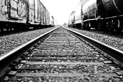 double siding (beau patrick coulon) Tags: railroad blackandwhite contrast junk tracks trains freighttrains siding cinders hobos trainhopping 2mile sunsetroute