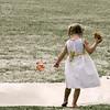 Pigtails, Pinwheel, Pizza, and a Puddle (maryanne.pfitz) Tags: girl grass children puddle spring child candid pizza barefoot pinwheel pigtails wi tomahawk partydress maryannepfitzinger