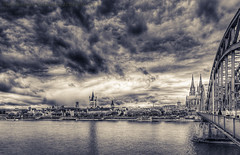 The Cathedral from the Deutz side (mlphoto) Tags: travel bridge sky blackandwhite bw panorama cloud architecture clouds river germany deutschland cityscape cathedral pentax kirche cologne himmel wolken sigma wideangle kln sw sight brcke rhein hdr lightroom klnerdom colognecathedral toning weitwinkel hohenzollernbrcke photomatix uww schwarzweis flus ultraweitwinkel k20d pentaxk20d grosstmartin mlphoto sigma816 lightroom4 markuslandsmannzenfoliocom