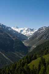 Towards The Moiry Dam (Jeremy Vickers Photography) Tags: road trees summer snow mountains alps forest spectacular switzerland hiking path altitude dramatic bluesky trail valley peaks valais canonef35mmf14lusm valdanniviers canoneos40d moirydam