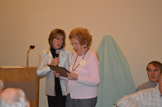 Volunteer Party : Natalie Perkins (right), a long-time Tower Hill Volunteer from Shrewsbury, reviews her recognition certificate with Joann Vieira, Tower Hill's Director of Horticulture.