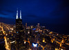 City Lights (Paul Aparicio) Tags: city blue urban chicago architecture night photography lights downtown searstower aerial helicopter che citygrid photographyblog willistower thephotographyblog chicagoaerialphotography