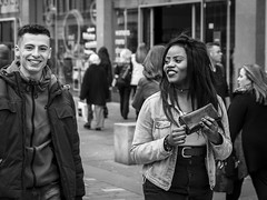 Infectious Smiles (Leanne Boulton) Tags: life street city uk light boy shadow portrait people urban blackandwhite bw woman white man black detail male texture girl monochrome smile face smiling female canon 50mm mono scotland living blackwhite eyecontact friendship faces natural emotion humanity outdoor expression glasgow candid joy culture streetphotography happiness streetlife scene depthoffield human shade 7d laughter feeling society depth tone facial candidstreetphotography candideyecontact