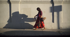 shadow charmer (ivosloman) Tags: street shadow red neworleans barefoot barfus canonfd50mm14