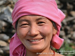 2016-05a Circling the Annapurnas (60) (Matt Hahnewald) Tags: bokeh youngmagarwoman dhampu myagdidistrict matthahnewaldphotography facingtheworld photo image closeup streetportrait headshot outdoor worldcultures cultural oneperson people female adult ethnic horizontalformat human eyes eyecontact photography consent empathy rapport portrait portraiture environmentalportrait ethnicportrait travelportrait traveldestination colour 43aspectratio posing asia southasia nepal himalayas annapurnacircuit nikond3100 trekking colourful enface frontview villager headscarf depthoffield earrings smiling teeth beautiful wrinklednose annapurnahimal nikkorafs50mmf18g primelens 50mm humanface colourpink