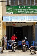 Waiting for Service (Mike Hohman) Tags: missing waiting cambodia watch smoking motorbike repair motorcycle service bp kampot