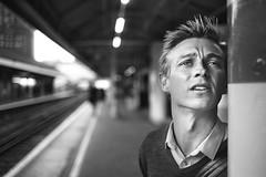 Luke (TGKW) Tags: bridge boy portrait people blackandwhite man london station standing train bokeh expression luke platform 4878