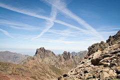 (Raphs) Tags: blue light sky sun mountains lines clouds landscape rocks view corse gr20 corsica wide clear outlook rough canoneos350d steep gettyimages raphs cirquedelasolitude tamronspaf1750mmf28xrdiiildaspherical